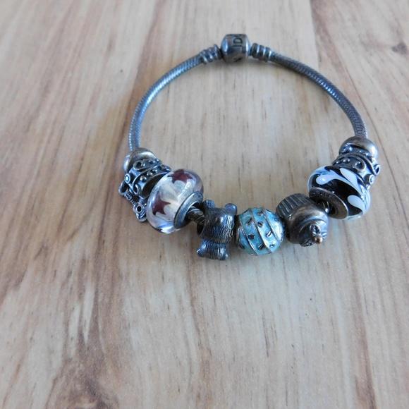 Pandora Jewelry - Pandora Bracelet with several charms!